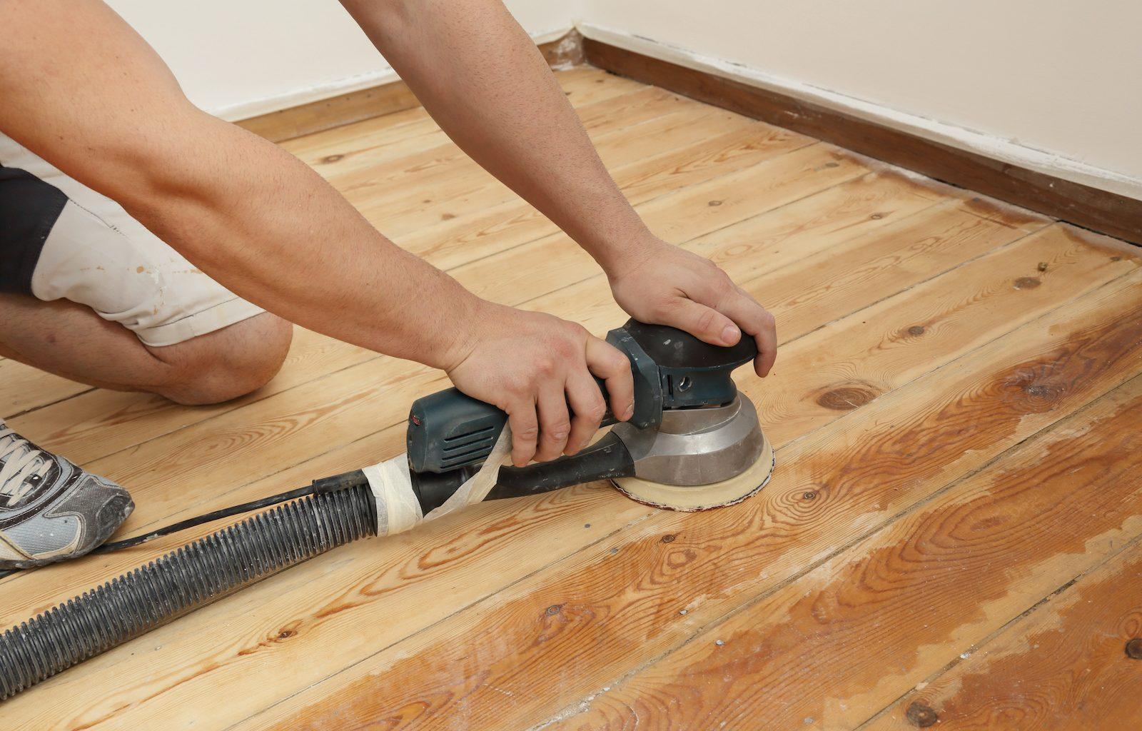 Hardwood floor orbital sander being used